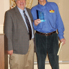 CWONJ President Mike Conte presents Simoniz USA CEO Bill Gorra with a token of the board's thanks for his presentation.